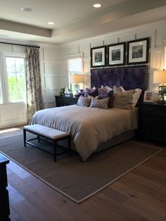Purple headboard with matching pillows...would do curtains in same fabric.  Like the grey bedding and blck/brwn end tables