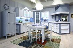 "SANDY, la cucina in stile shabby chic, crea un'atmosfera rilassante e familiare. Fil rouge di SANDY è l'effetto invecchiato, recuperato e impreziosito da una muratura color mirtillo. SANDY is the first kitchen in shabby- chic style, a ""must have"" for everyone who considers the luxurious vintage a real  lifestyle. The fil rouge of the model  SANDY is the aged finish  enhanced by a masonry with walls in  blueberry colour."