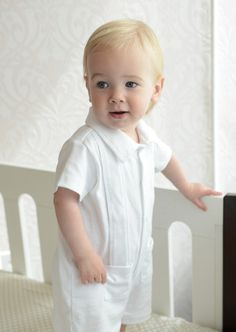 A little prep in your baby's step!  Our Pleated Romper has a wing tip collar,...