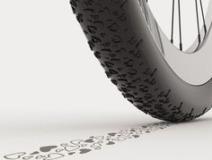 The bicycle tire features heart-shaped knobs that create playful tracks on the streets.