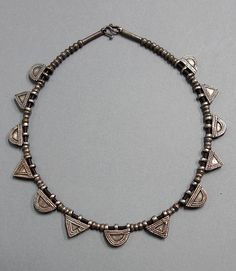 Africa | Contemporary necklace made with old silver alloy telsum amulets from the Oromo people of Ethiopia.  Combined with old silver beads | 125€