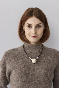 Seita is a necklace with a wood bead and leather designed by Pauliina Aarikka. www.aarikka.com