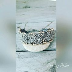 Beautiful grey/silver coloured cord with little beads knotted into this great bracelet. Its ajustable in size