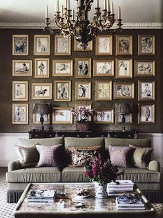 gallery wall in living room...just so interesting,,,love the colors