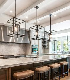 Cube cage lighting, complete with Edison bulbs, complements an oversized kitchen island.