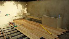 Constructing corner floating benches & Garapa hardwood deck