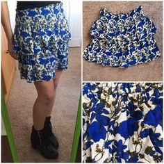 "Dolls Point, adorable, boutique,  stretchy skirt. Dolls Point, adorable, boutique,  stretchy, flowy mini skirt with two ruffle layers. White with blue floral pattern.  Size M. 100% viscose.  Super stretchy elastic waist. Flat measurements: Waist 13.75"" / Length 16"". Dolls Point Skirts"