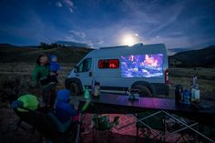 Get a mini projector and watch a movie under the stars.
