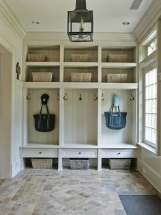 This mudroom is the perfect example of how to mix beauty and function. Adding cubbies, hooks, and baskets gives you a place to store everything you need without the clutter. Not to mention shiplap walls inside each one! Clean but still interesting.