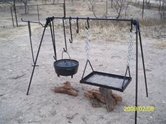 Want to buy Dutch oven table? Portable Dutch oven and Grill Cook Set is designed to hold one or more Dutch ovens and/or a grill over a bed of coals. Dutch Oven Table, Dutch Oven Cooking, Fire Cooking, Cast Iron Cooking, Cooking On The Grill, Outdoor Cooking, Cooking Oil, Cooking Light, Cooking Salmon