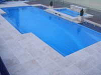 Travertine Linen Tumbled Unfilled for coping and surround paving. The Pool Tile Company - Swimming Pools Brisbane