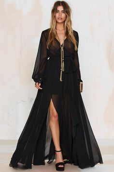 The Go Your Own Way Dress is made in sheer black chiffon and features wide sweeping skirt, slits, plunging neckline, and elasticized waist.