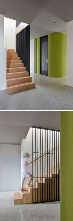 Inside this modern house, polished-concrete screed floors and charcoal colored ceilings create a contemporary appearance, while a lime green rendered cellar adds a pop of color. Light wood stairs lead up to the second floor of the home. #PolishedConcreteFloors #Flooring #WoodStairs #Stairs #Cellar