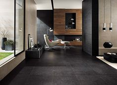 In this image: Seastone color Black 24x24, 12x24, color Greige 12x24 and Etic color Palissandro 4x36