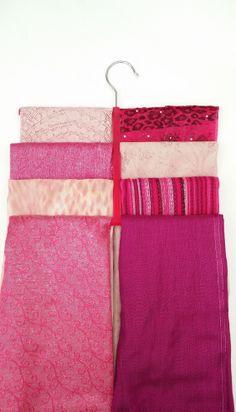 All my pink scarves on a pink hanger!! Organise your scarves using our scarf hanger, visit: www.hanger-management.co.uk