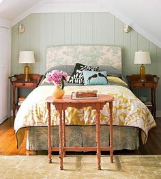 painted wall paneling bedroom, again with the soft blue/green. More of a mix of patterns in the bedroom linens too.