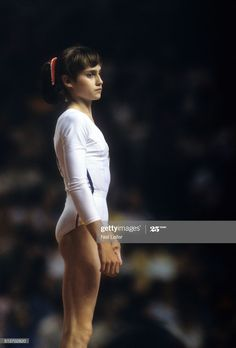 View of Romania Nadia Comaneci during Women's competition at Montreal Forum. Montreal, Canada - ) Get premium, high resolution news photos at Getty Images Artistic Gymnastics, Olympic Gymnastics, Olympic Sports, Nadia Comaneci Perfect 10, Meg Donnelly, Gym Leotards, Female Gymnast, Dynamic Poses, Summer Olympics