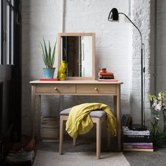 Extraordinary Dressing Table Design with White Wall Brick and Floor Lamps