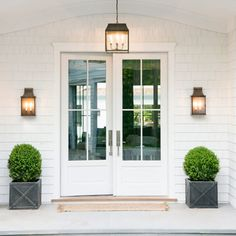extra tall front door.  love the boxwoods in planters, too :)
