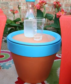 Terra Cotta Table - Outdoor paint turns a terra cotta pot and tray turn into an outdoor table with storage space.