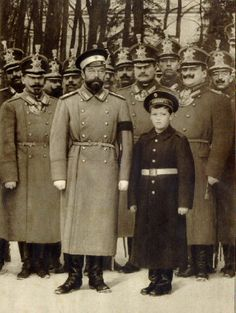 Nicholas II & Alexei posing with the troops.