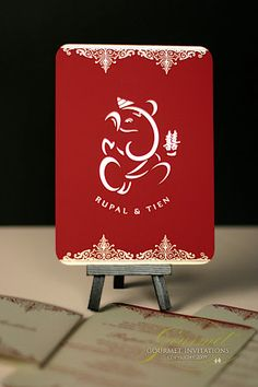 Rupal and Tien need fusion wedding invitations for the Indian and Chinese wedding. We designed a Ganesh holding the double happiness Chinese symbol! The red suede was printed with gold foil and we complemented the rest of the suite with gold cardstock printed with digital flat red printing. The guests' names were printed on sashes and wrap around the entire suite. Click to see more of these lovely invitations or pin to save for later!