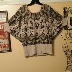 Animal print, sweater top, Worthington size XL This is a round neckline sweater top with an animal print design, by Worthington size XL.  Three quarter length sleeves that have a dolman design.  Banded waistband and sleeve cuffs in a beige color.  A great sweater, barely worn in great condition. Worthington Tops