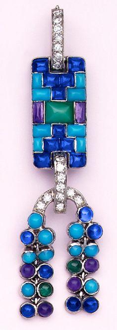 Turquoise, buff-cut sapphire, cabochon-cut amethyst, cabochon-cut emerald, chalcedony, diamond, and platinum pendant.