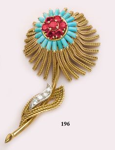 """Burma ruby, turquoise, diamond and gold flower brooch. French. This brooch is typical of high fashion French """"jet-set"""" jewelry of the 1960's with petals of braided 18kt yellow gold that move and sway when worn. The center of the brooch is of turquoise baguettes with a cluster of vibrant rubies and a stem of 18kt yellow gold with a diamond and gold leaf"""