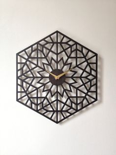 Lotus Clock. Geometric laser cut wood wall by SarahMimoClocks, $127.00