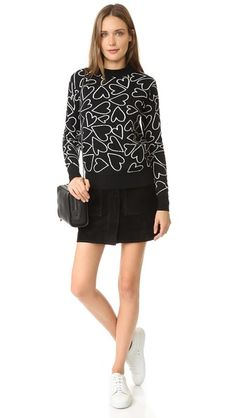 A scribbled heart print lends a cheery touch to this cozy Markus Lupfer sweater. Banded neckline. Long sleeves.