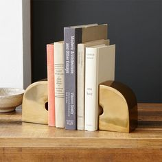 Geo Brass Bookends - Double Arc | West Elm ( I could really use a set of these!)