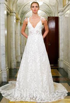 A lace @vkkny wedding dress with a sheer midriff | Brides.com