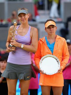 Maria Sharapova - Mutua Madrid Open - Day Nine. Maria Sharapova of Russia and Simona Halep of Romania hold there winner and runner up trophies after their final match during day nine of the Mutua Madrid Open tennis tournament at the Caja Magica on May 11, 2014 in Madrid, Spain.