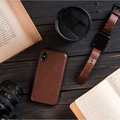 Shop iPhone cases & accessories made from the finest materials. Browse our specialized selection of Apple Watch Straps, suite of durable cables, and collection of products to keep you powered on the go. Made for the modern Nomad. Apple Watch Accessories, Iphone Accessories, Leather Accessories, Coffee Apple, Iphone Watch, Vintage Gentleman, Apple Books, Phone Gadgets, Flat Lay Photography