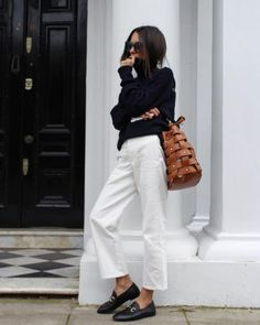 Love this classic black and white outfit with a pop of cognac. Black turtleneck sweater, white pants, black mules