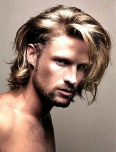 A hair cut for men with intermediate length hair and no shirts