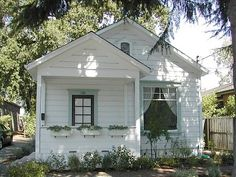 All White Cottage With Colorful Trim Living Style Small House