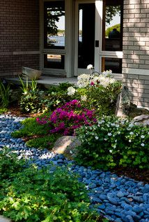 Wraparound be nice and landscaping on pinterest for Landscaping rocks grand rapids