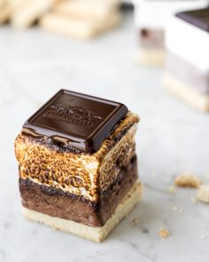 Make the most decadent homemade marshmallow s'mores! Start with a buttery shortbread cookie, add a roasted mocha almond marshmallow and top with chocolate. Best Dessert Recipes, Candy Recipes, Fun Desserts, Sweet Recipes, Baking Recipes, Cookie Recipes, Delicious Desserts, Yummy Food, Fudge Recipes