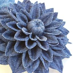 Denim flower corsage is a perfect finishing touch to many outfits from denim skirts and jeans to romantic dresses. The versatility of denim knows no limits. Denim dahlia corsage is ideal for denim themed weddings as it can be pinned to the bridal dress or decorate a wedding guests outfit. Made of cotton denim dahlia corsage is your choice if you are looking for a gift for the second wedding anniversary which is traditionally associated with cotton. The denim flower comes in light coloured…