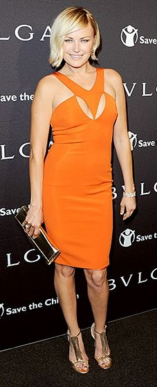 Orange crush! The I'll See You in My Dreams actress looked sultry in a form-fitting Cushnie et Ochs dress with bold cutouts. Akerman paired the look with a bronze envelop clutch and matching T-bar sandals.