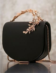 6d51e46002911 black and rose gold handbag with floral design