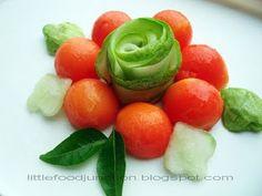 Tricolor Flower Salad  (cucumber, curry leaves, papaya balls.)
