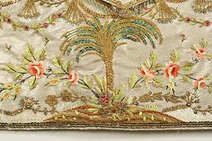 Detail embroidery waistcoat. Ensemble, coat and waistcoat, France, c. 1765. Saffron silk, metal buttons; waistcoat silk satin with floral embroidery in coloured silk.