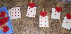 Match number clothespins to cards with hearts- would be great using playing cards.  Could also be used with problems.