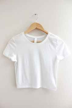 4b9557333be26d Solid white crop top with short sleeves and no graphic. Available in two  sizes XS