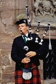 Bagpiper at Glamis Castle in Scotland,