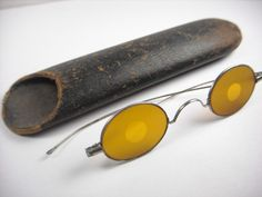 Antique eyeglasses Civil War era sharpshooter spectacles with yellow lenses.