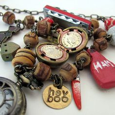 This is a set of three necklaces illustrating the Harper Lee novel To Kill a Mockingbird.    The first necklace shows the progressing